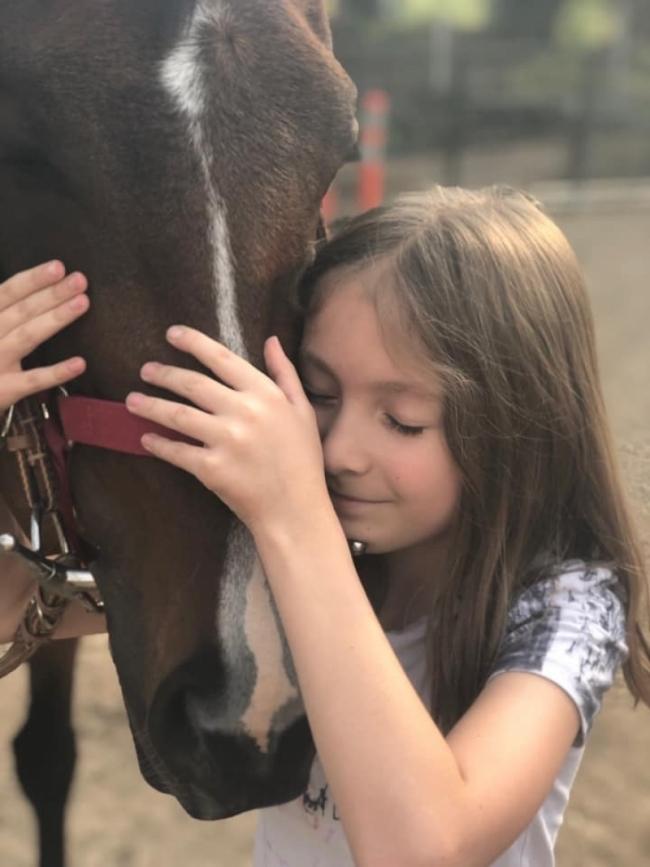 Любительница котов и лошадей
